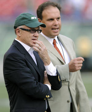 photo - FILE - In this Sept. 3, 2009 file photo, New York Jets Chairman and CEO Woody Johnson, left, and General Manager Mike Tannenbaum talk prior to an NFL preseason football game against the Philadelphia Eagles at Giants Stadium in East Rutherford, N.J. The New York Jets have fired Tannenbaum and say coach Rex Ryan will be back next season. Johnson said in a statement Monday, Dec. 31, 2012, that &quot;like all Jets fans, I am disappointed with this year&#039;s results.&quot; (AP Photo/Bill Kostroun, File)