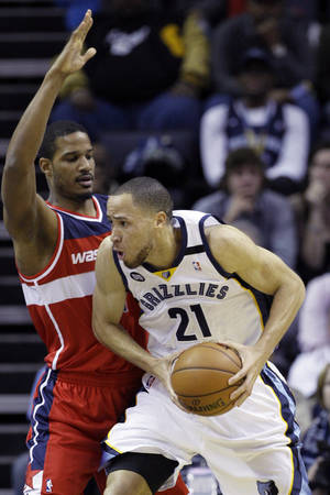 photo - Memphis Grizzlies' Tayshaun Prince (21) is pressured by Washington Wizards' Trevor Ariza during the first half of an NBA basketball game in Memphis, Tenn., Friday, Feb. 1, 2013. Prince, formerly of the Detroit Pistons, was obtained by the Grizzlies in a three-team deal earlier in the week. (AP Photo/Danny Johnston)