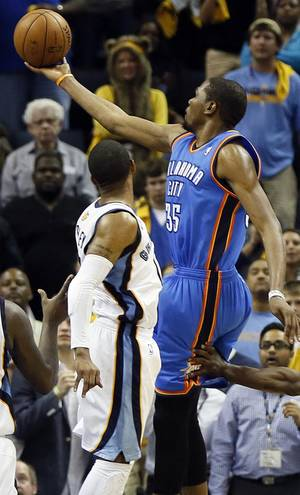Photo - Oklahoma City's Kevin Durant (35) takes the game-tying shot past Memphis' Mike Conley (11) at the end of regulation during Game 4 of the second-round NBA basketball playoff series between the Oklahoma City Thunder and the Memphis Grizzlies at FedExForum in Memphis, Tenn., Monday, May 13, 2013. Memphis won 103-97 in overtime. Photo by Nate Billings, The Oklahoman