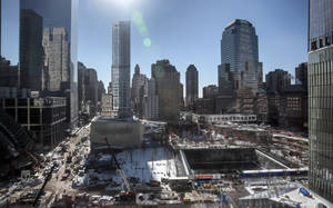Photo - A view from 7 World Trade Center shows ongoing construction at the World Trade Center site on Friday Jan. 24, 2014, in New York. After years of delays due to funding disputes, engineering challenges and a nearly disastrous flood,  a museum dedicated to victims of the 9/11 terror attacks will open to the public in mid-May in a giant cavern beneath the World Trade Center site — with a world-class admissions price of $24. (AP Photo/Bebeto Matthews)