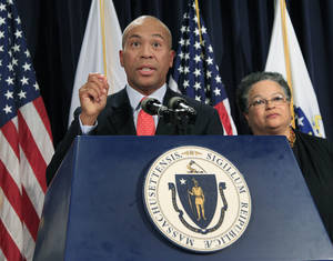 Photo -   FILE - In this June 28, 2012, file photo, Massachusetts Gov. Deval Patrick speaks, as Health and Human Services Secretary JudyAnn Bigby listens at right, during a news conference at the Statehouse in Boston, where he spoke about the U.S. Supreme Court's decision to uphold President Barack Obama's health care overhaul. Some of President Barack Obama's former advisers are proposing major changes aimed at controlling health care costs as political uncertainty hovers over his health law. Call it Health Care Overhaul, Version 2.0. Their biggest idea is a first-ever budget for the nation's $2.8-trillion health care system, through negotiated limits on public and private spending in each state. The approach broadly resembles a Massachusetts law signed this summer by Patrick that puts pressure on hospitals, insurers, and other major players to keep rising costs within manageable limits. It could become the Democratic counterpoint to private market strategies favored by Republican presidential nominee Mitt Romney and running mate Paul Ryan. (AP Photo/Elise Amendola, File)