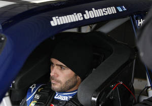 Photo -   Driver Jimmie Johnson sits in his car during practice for the NASCAR Sprint Cup Series auto race at Kansas Speedway in Kansas City, Kan., Thursday, Oct. 18, 2012. (AP Photo/Colin E. Braley)