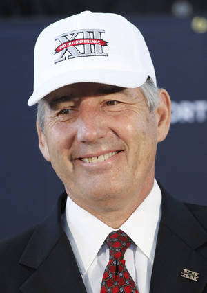 Photo -   New Big 12 Conference Commissioner Bob Bowlsby wears a cap at the news conference introducing him to the media at Big 12 headquarters Friday, May 4, 2012, in Irving, Texas. (AP Photo/LM Otero)