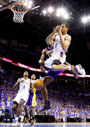 photo - Oklahoma City's Thabo Sefolosha (2) falls after being fouled by Los Angeles' Metta World Peace (15) during Game 5 in the second round of the NBA playoffs be