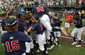 Photo - Vanderbilt players celebrate their 12-5 victory over Stanford after an NCAA college baseball tournament super regional game Sunday, June 8, 2014, in Nashville, Tenn. (AP Photo/Wade Payne)