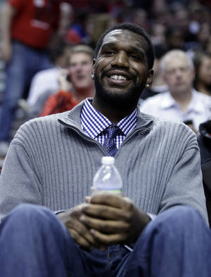 Photo - Former Portland Trail Blazers center Greg Oden watches from the crowd during the first quarter of an NBA basketball game between the Trail Blazers and Memphis Grizzlies in Portland, Ore., Wednesday, April 3, 2013.(AP Photo/Don Ryan)