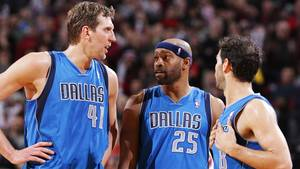 Photo - PORTLAND, OR - DECEMBER 7:  Dirk Nowitzki #41, Vince Carter #25 and Jose Calderon #8 of the Dallas Mavericks talk during the game against the Portland Trail Blazers on December 7, 2013 at the Moda Center Arena in Portland, Oregon. NOTE TO USER: User expressly acknowledges and agrees that, by downloading and or using this photograph, user is consenting to the terms and conditions of the Getty Images License Agreement. Mandatory Copyright Notice: Copyright 2013 NBAE (Photo by Sam Forencich/NBAE via Getty Images)