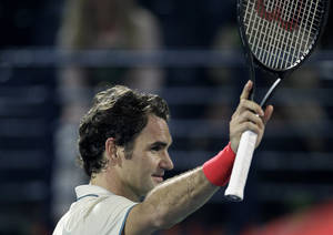 Photo - Roger Federer of Switzerland celebrates after he beats Lukas Rosol of the Czech Republic during a quarter final match of the Dubai Duty Free Tennis Championships in Dubai, United Arab Emirates, Thursday, Feb. 27, 2014. (AP Photo/Kamran Jebreili)