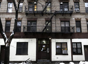 Photo - The building at 320 Mott St. is seen in New York, Wednesday, Feb. 5, 2014. Four people are in custody on drug charges after police executed search warrants at three apartments in the building. (AP Photo/Seth Wenig)