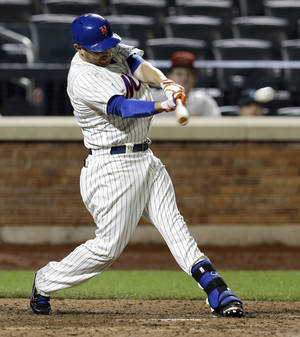 Photo - New York Mets' Andrew Brown hits the game winning single during the 13th inning of the baseball game against the Arizona Diamondbacks at Citi Field, Tuesday, July 2, 2013, in New York. The Mets beat the Diamondbacks 5-4. (AP Photo/Seth Wenig)