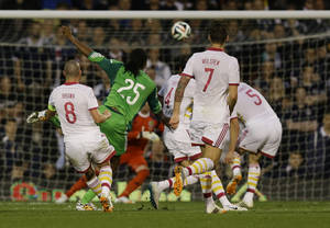 Photo - Nigeria's Michael Uchebo, second left, scores a goal during the international friendly soccer match between Nigeria and Scotland at Craven Cottage Stadium in London, Wednesday, May 28, 2014. (AP Photo/Kirsty Wigglesworth)