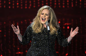 Photo - Singer Adele performs during the Oscars at the Dolby Theatre on Sunday Feb. 24, 2013, in Los Angeles.  (Photo by Chris Pizzello/Invision/AP)