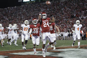 Photo -   Oklahoma running back Brennan Clay (24) celebrates after scoring the game winning touchdown against Oklahoma State in overtime of an NCAA college football game in Norman, Okla., Saturday, Nov. 24, 2012. Oklahoma won in overtime 51-48. (AP Photo/Sue Ogrocki)