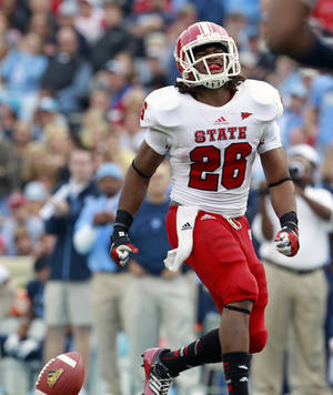 Photo -   North Carolina State running back Tony Creecy (26) reacts after fumbling and dropping a pass during the second half of an NCAA college football game against North Carolina at Kenan Stadium in Chapel Hill, N.C., Saturday, Oct. 27, 2012. (AP Photo/The News & Observer, Ethan Hyman)