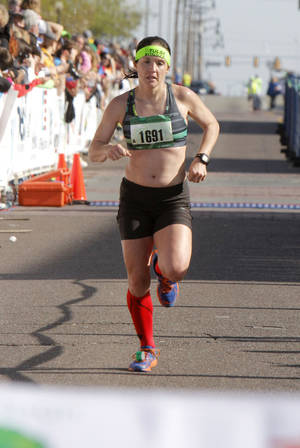 Photo - McKale Davis is the winning female runner of the Oklahoma City Memorial Marathon in Oklahoma City, Sunday, April 28, 2013,  By Paul Hellstern, The Oklahoman