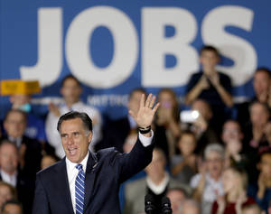 Photo -   Republican presidential candidate, former Massachusetts Gov. Mitt Romney waves to supporters before speaking at a campaign event at Wisconsin Products Pavilion at State Fair Park, Friday, Nov. 2, 2012, in West Allis, Wisc. (AP Photo/David Goldman)