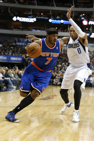 Photo - New York Knicks forward Carmelo Anthony (7) drives around Dallas Mavericks forward Shawn Marion (0) during the first half of an NBA basketball game, Sunday, Jan. 5, 2014, in Dallas. (AP Photo/Sharon Ellman)