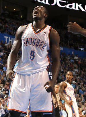 Photo - Oklahoma City's Serge Ibaka (9) celebrates a basket during the preseason NBA game between the Oklahoma City Thunder and the Charlotte Bobcats at Chesapeake Energy Arena in Oklahoma City, Tuesday, Oct. 16, 2012. Photo by Sarah Phipps, The Oklahoman