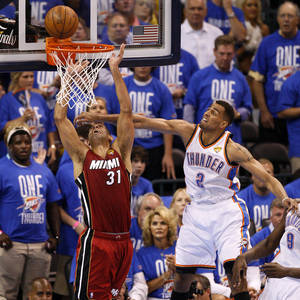 Photo - NBA BASKETBALL: Oklahoma City's Thabo Sefolosha (2) defends Miami's Shane Battier (31) during Game 1 of the NBA Finals between the Oklahoma City Thunder and the Miami Heat at Chesapeake Energy Arena in Oklahoma City, Tuesday, June 12, 2012. Photo by Nate Billings, The Oklahoman