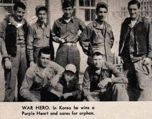 James Bumgarner, lower left, and other soldiers pose with a Korean orphan he looked after during his Korean War service. Garner nicknamed the boy ' Jocko.'