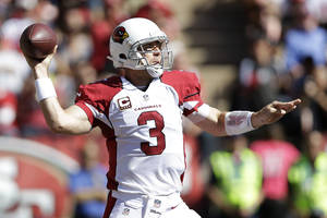 Photo - Arizona Cardinals quarterback Carson Palmer (3) passes against the San Francisco 49ers during the first quarter of an NFL football game in San Francisco, Sunday, Oct. 13, 2013. (AP Photo/Marcio Jose Sanchez)