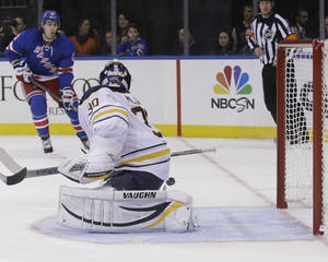 Photo - Buffalo Sabres goalie Ryan Miller (30) attempts to stop a shot by New York Rangers' Chris Kreider as Brad Richards (19) watches during the second period of an NHL hockey game Thursday, Oct. 31, 2013, in New York. Kreider scored on the play. (AP Photo/Frank Franklin II)