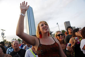 Photo - Below:  Amy Brooks, of Oklahoma City, dances along to the Randy Rogers Band song at OKCFest. <strong>KT King</strong>
