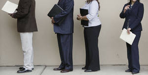 Photo - Job seekers line up for a career fair in Oak Brook, IL. Oklahoma's long-term unemployed no longer will be eligible for Tier 3 benefits. (AP Photo/M. Spencer Green) ORG XMIT: ILMG106 <strong>M. Spencer Green - AP</strong>