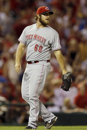 Photo - Cincinnati Reds relief pitcher J.J. Hoover watches as a ball hit by St. Louis Cardinals' Allen Craig for a grand slam leaves the park during the seventh inning of a baseball game Monday, Aug. 26, 2013, in St. Louis. (AP Photo/Jeff Roberson)
