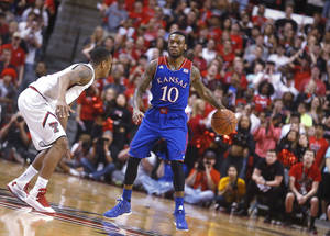Photo - Texas Tech's Robert Turner defends Kansas' Naadir Tharpe (10) during their NCAA college basketball game in Lubbock, Texas, Tuesday, Feb, 18, 2014. (AP Photo/Lubbock Avalanche-Journal, Stephen Spillman)