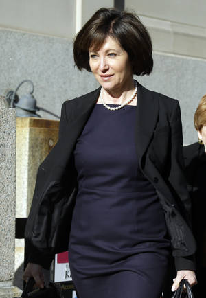 Photo - FILE - In this May 2, 2014 file photo, Francine Katz leaves the Civil Court building in St. Louis. Katz sued Anheuser-Busch in 2009 for gender discrimination, a year after resigning as vice president of communications and consumer affairs for the maker of Budweiser, Bud Light and other beers. Closing arguments are expected Thursday, May 15, 2014 in the case after nearly three weeks of testimony. (AP Photo/Jeff Roberson, File)