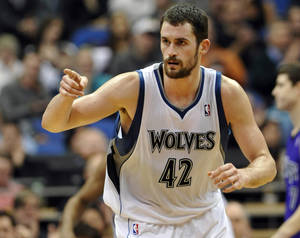 Photo -   FILE - In this Jan. 16, 2012, file photo, Minnesota Timberwolves' Kevin Love reacts during the second half of an NBA basketball game against the Sacramento Kings in Minneapolis. Love will miss the next six to eight weeks after breaking his right hand in a workout on Wednesday, Oct. 17, 2012. (AP Photo/ Jim Mone, File)