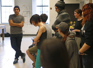 Photo - Artist Yatika Fields, a Stillwater native, talks March 29 with students at Oklahoma State University. Fields is teaming up with OSU students to create a series of murals for a live painting event on Friday. Photo by Bryan Terry, The Oklahoman <strong>Bryan Terry</strong>