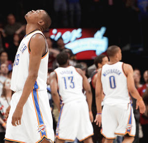 photo - Thunder forward Kevin Durant reacts after he missed a 3-pointer in the final second of Oklahoma City's 92-87 loss to Portland on Sunday.  PHOTO BY JOHN CLANTON, THE OKLAHOMAN