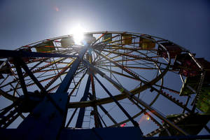 Photo - The Ferris wheel is silhouetted during  the Freedom Festival at Eldon Lyon Park in Bethany, Wednesday, July 4, 2012. Photo By Steve Gooch, The Oklahoman