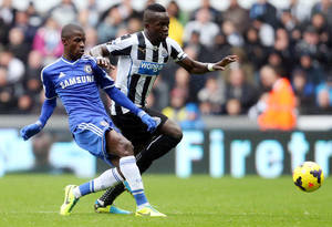 Photo - Newcastle United's captain Chiek Tiote, right, vies for the ball with Chelsea's Ramires, left, during their English Premier League soccer match at St James' Park, Newcastle, England, Saturday, Nov. 2, 2013. (AP Photo/Scott Heppell)