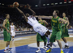 photo - Kevin Durant and the United States' starters will need more help from their bench if they are going to be successful at the FIBA World Championships. AP PHOTO