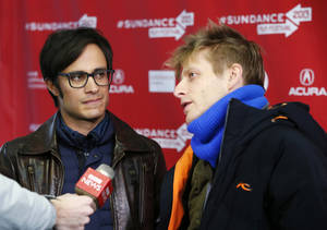 "Photo - Actor Gael Garcia Bernal, left, and director Marc Silver are interviewed at the premiere of ""Who Is Dayani Cristal?"" during the 2013 Sundance Film Festival on Thursday, Jan. 17, 2013 in Park City, Utah. (Photo by Danny Moloshok/Invision/AP)"