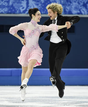 Photo - Meryl Davis, left, and Charlie White, of the United States, compete in the ice dance short dance figure skating competition at the Iceberg Skating Palace during the Winter Olympics, Sunday, Feb. 16, 2014, in Sochi, Russia. (AP Photo/The Canadian Press, Paul Chiasson)