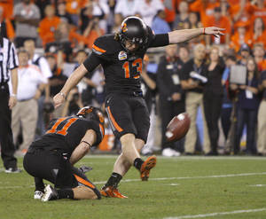 Photo - Oklahoma State's Quinn Sharp (13) kicks the game-winning field goal during the Fiesta Bowl between the Oklahoma State University Cowboys (OSU) and the Stanford Cardinal at the University of Phoenix Stadium in Glendale, Ariz., Tuesday, Jan. 3, 2012. Photo by Bryan Terry, The Oklahoman