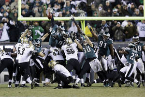 Photo - New Orleans Saints' Shayne Graham (3) kicks the game-winning field goal during the second half of an NFL wild-card playoff football game against the Philadelphia Eagles, Saturday, Jan. 4, 2014, in Philadelphia. New Orleans won 26-24. (AP Photo/Julio Cortez)