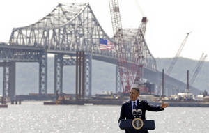 Photo - President Barack Obama speaks near the base of the Tappan Zee Bridge, Wednesday, May 14, 2014, in Tarrytown, N.Y. Obama is calling on Congress to pass a $302 billion transportation infrastructure bill that White House officials say would support millions of jobs while repairing the nation's crumbling roads and bridges. White House officials are touting the $3.9 billion Tappan Zee Bridge Replacement Project as a model for an expedited permitting and review process.(AP Photo/Julie Jacobson)