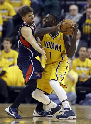 Photo - Indiana Pacers' Lance Stephenson (1) is defended by Atlanta Hawks' Kyle Korver during the first half in Game 1 of an opening-round NBA basketball playoff series on Saturday, April 19, 2014, in Indianapolis. (AP Photo/Darron Cummings)