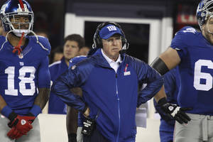 Photo - New York Giants head coach Tom Coughlin stands on the sidelines during the first half of an NFL football game against the Minnesota Vikings Monday, Oct. 21, 2013 in East Rutherford, N.J. (AP Photo/Peter Morgan)