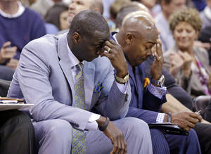 Photo - FILE - In this April 14, 2014, file photo, Utah Jazz's head coach Tyrone Corbin, left, lowers his head late in the fourth quarter during an NBA basketball game against the Los Angeles Lakers, in Salt Lake City, Utah. The Jazz announced Monday, April 21, 2014, that the team won't be offering Corbin a new contract. (AP Photo/Rick Bowmer, File)