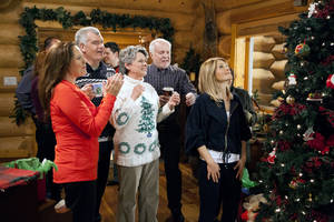 """Photo - This image released by Crown Media shows a scene from the Christmas TV movie """"Let it Snow,"""" one of the films to air on Hallmark TV channels for a week, beginning on Independence Day.  The stunt on the Hallmark and Hallmark Movie channels  continues into the early morning hours of July 15. Mostly, it will be repeats of the holiday movies that Hallmark traditionally airs during the last two months of the year. (AP Photo/Crown Media)"""