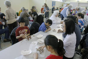 Photo - Children and their parents create clay horses during a sculpture class for kids at the National Cowboy &  Western Heritage Museum.  Photo By Paul Hellstern, The Oklahoman <strong>PAUL HELLSTERN - Oklahoman</strong>