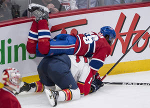 Photo - Montreal Canadiens' P.K. Subban falls over Florida Panthers' Drew Shore during second period of an NHL hockey game, Monday, Jan. 6, 2014 in Montreal. (AP Photo/The Canadian Press, Paul Chiasson)