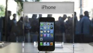 Photo - File photo - People queue outside the Apple Store as the iPhone 5 mobile phones went on sale in Amsterdam, Netherlands, Friday Sept. 28, 2012. (AP Photo/Peter Dejong)