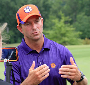 Photo - Clemson head football coach Dabo Swinney talks about the Tigers' upcoming 2014 season at his annual media golf outing at The Reserve at Lake Keowee in Sunset, S.C. on Tuesday, July 15, 2014. Clemson opens their NCAA college football season on August 30 at Georgia.(AP Photo/Anderson Independent-Mail, Mark Crammer) THE GREENVILLE NEWS OUT, SENECA NEWS OUT